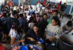 Families at the hurricane shelter, Sacacoyo, El Salvador